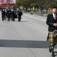 A bagpiper in a parade